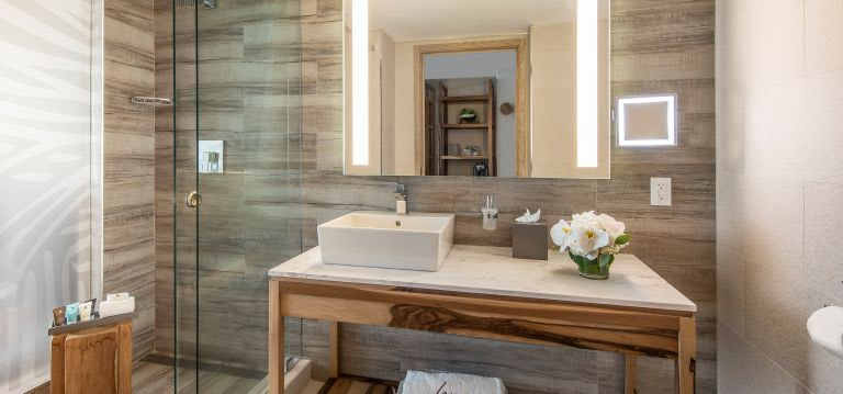A chic marble-clad bathroom has ample space and ammenities