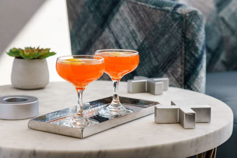 Orange cocktails on table