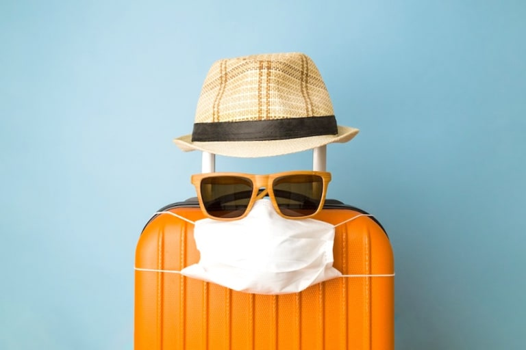 suitcase-hat-sunglasses-facemask