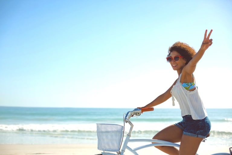 woman-on-bike-at-shore