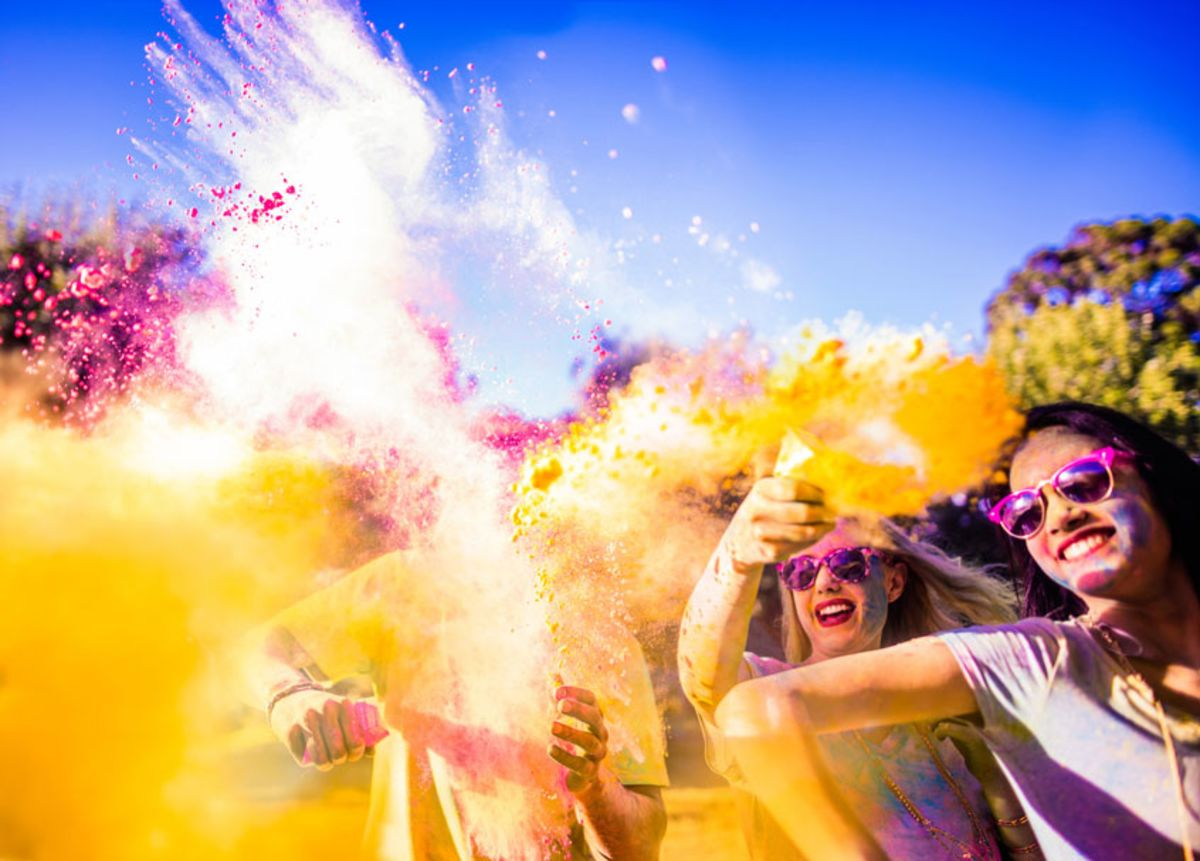 group-of-people-throwing-colored-powder