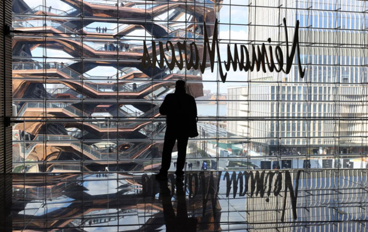 silhouette-of-man-standing-at-window-in-hudson-yards