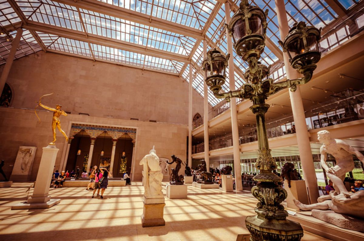 view-of statues-inside-the-met-under-glass-roof