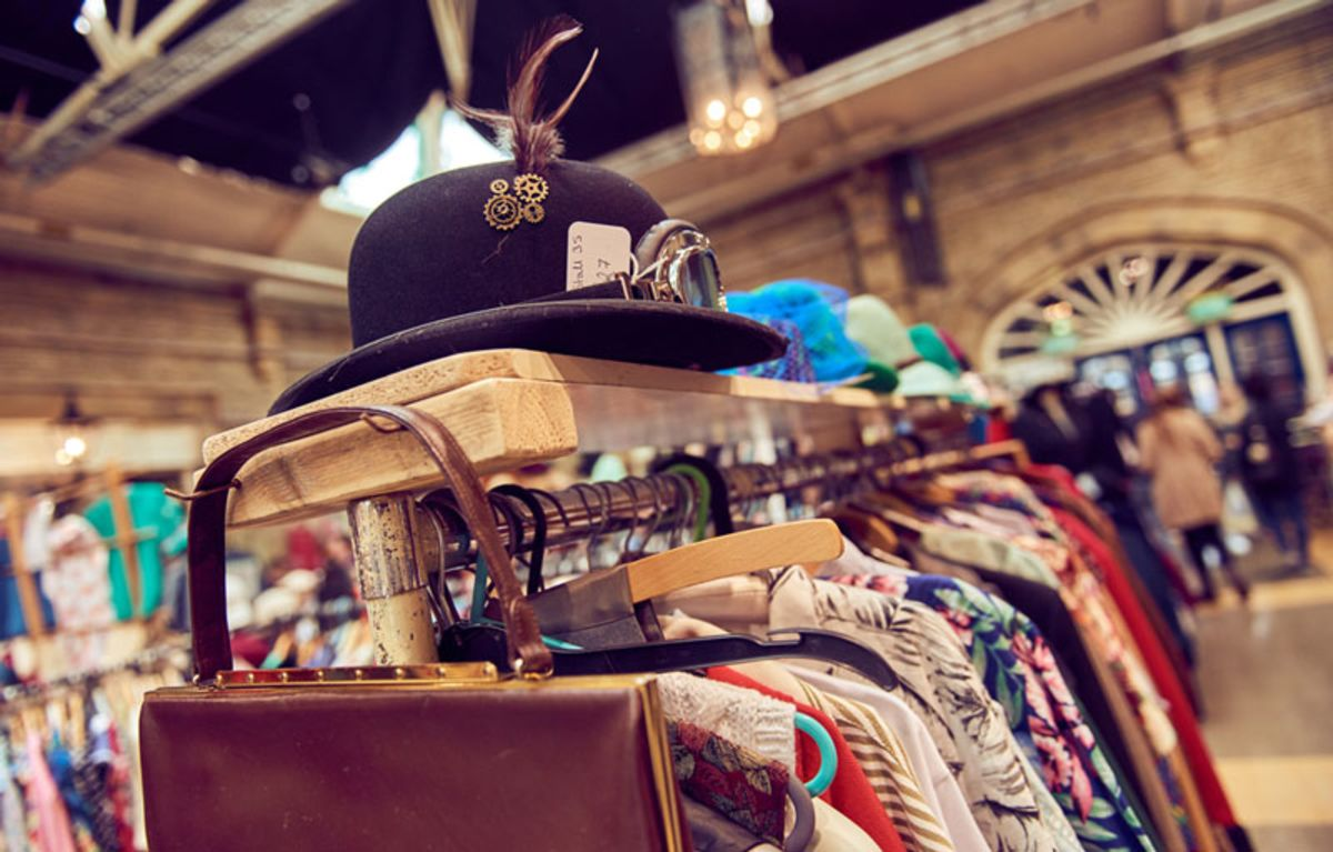 rack-with-hat-and-vintage-clothes-in-a-market