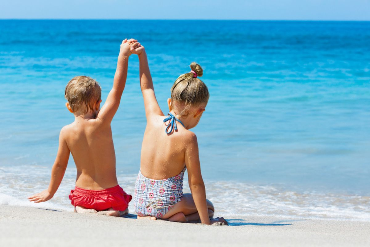 children-play-on-beach-miami