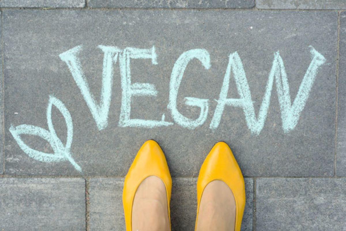 female-yellow-shoes-and-vegan-sign-on-pavement