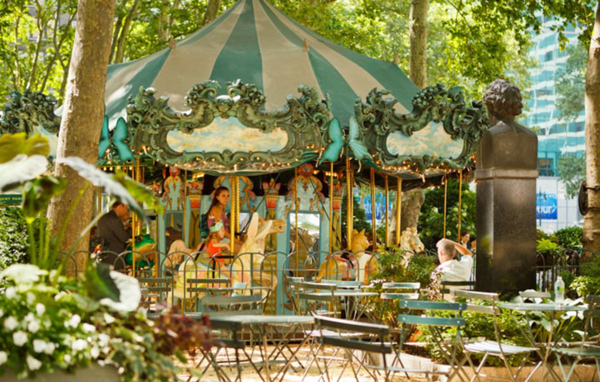 carousel-in-bryant-park-with-outdoor-tables-and-chairs-in-front