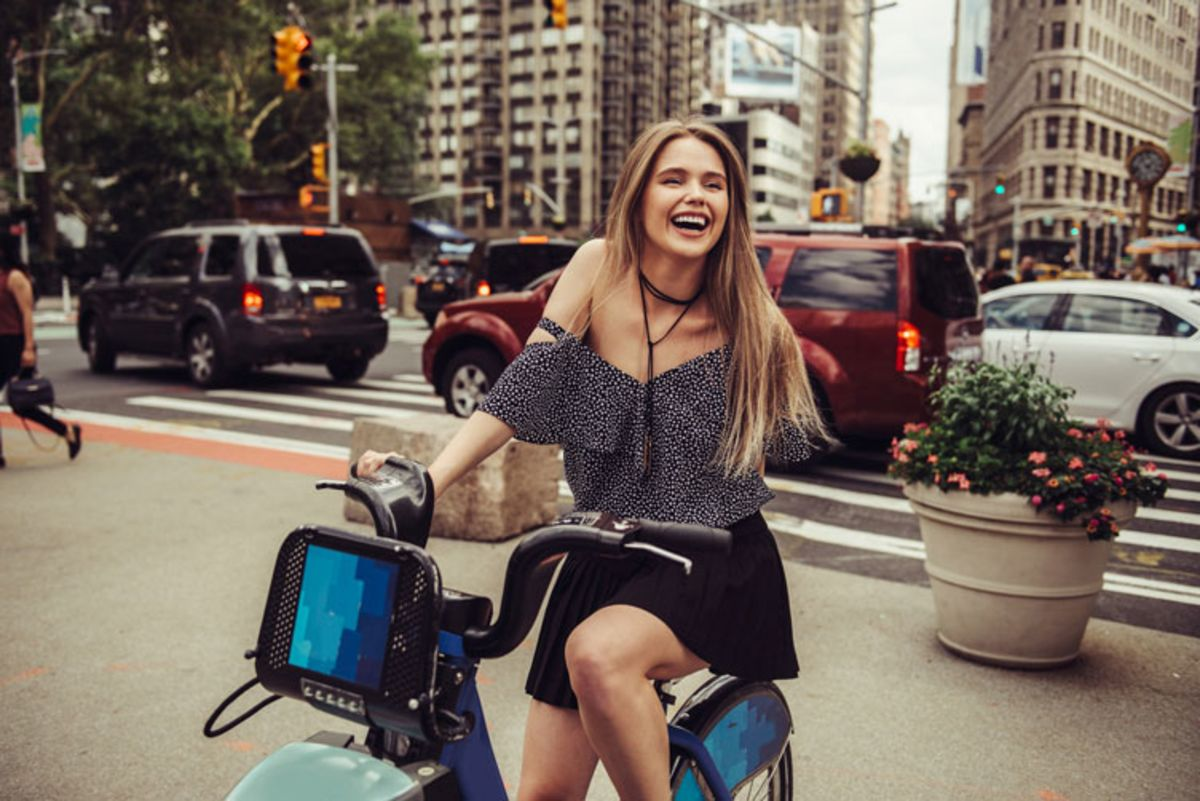 happy-young-woman-getting-a-citi-bike-bicycle