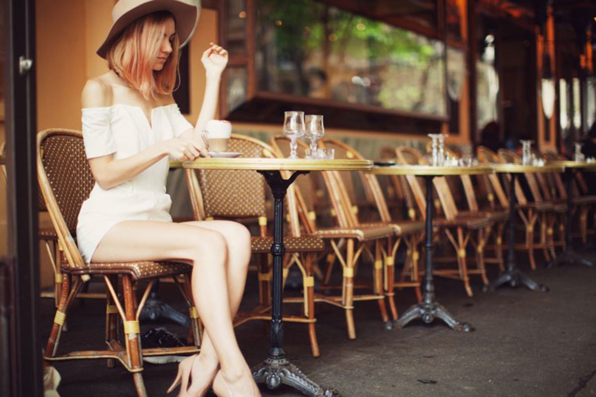 young-and-stylish-woman-having-a-coffee-at-french-cafe