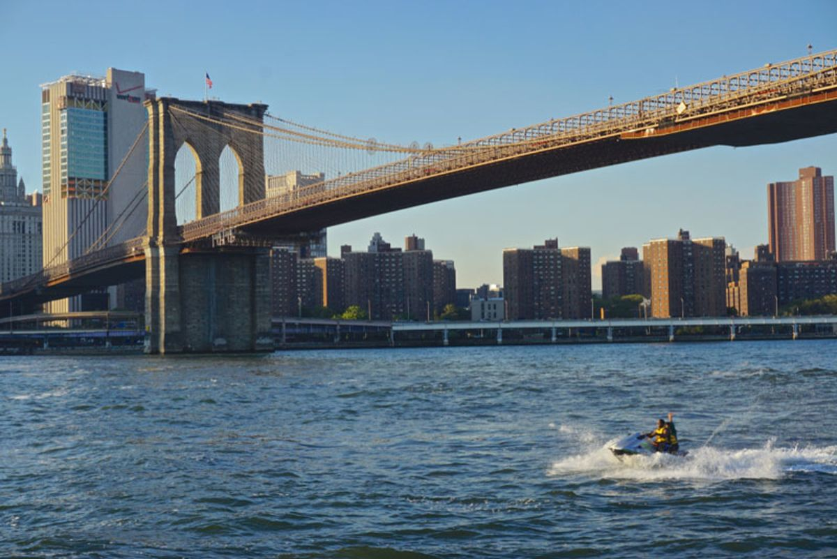 couple-jet-skiing-past-brooklyn-bridge
