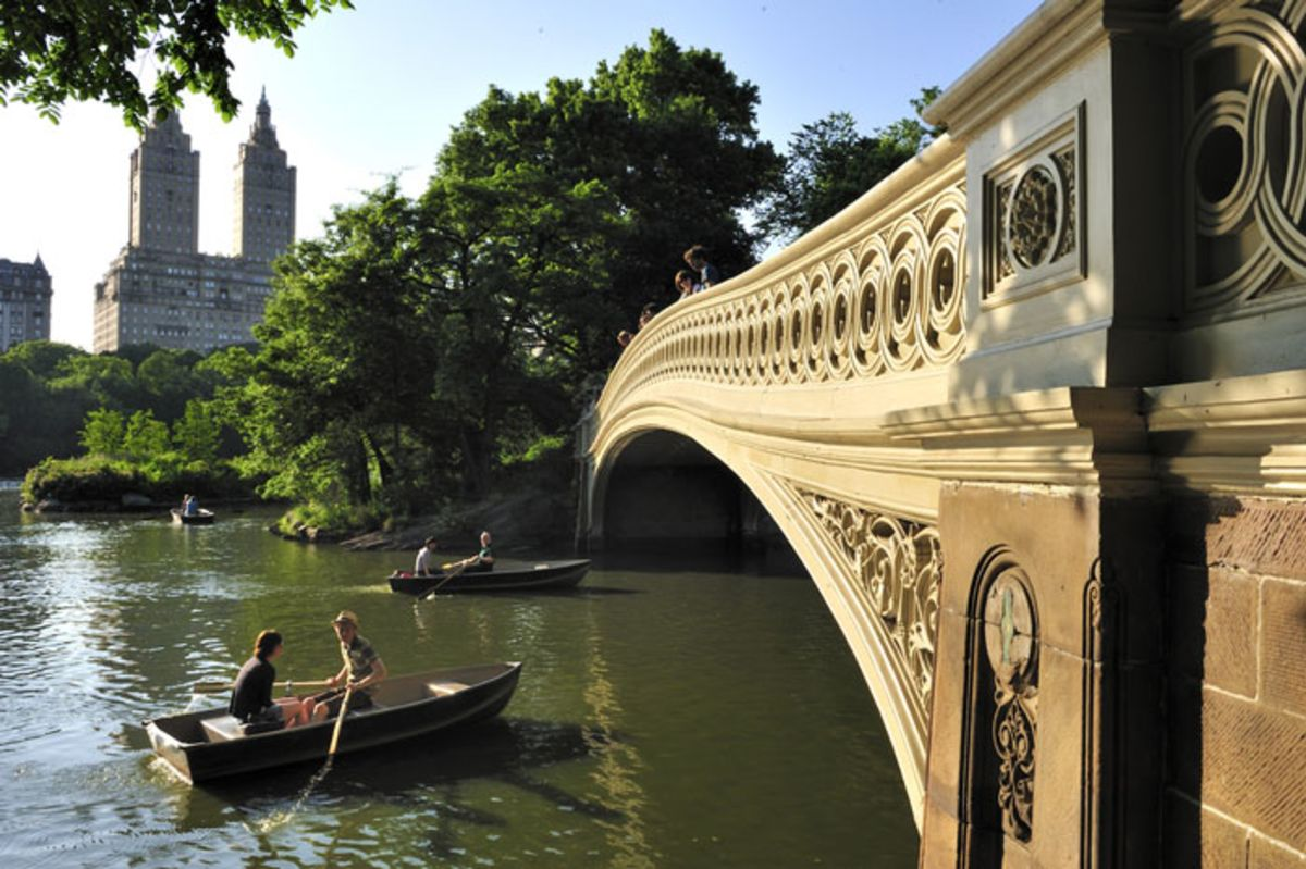 people-on-rowboats-near-bow-bridge