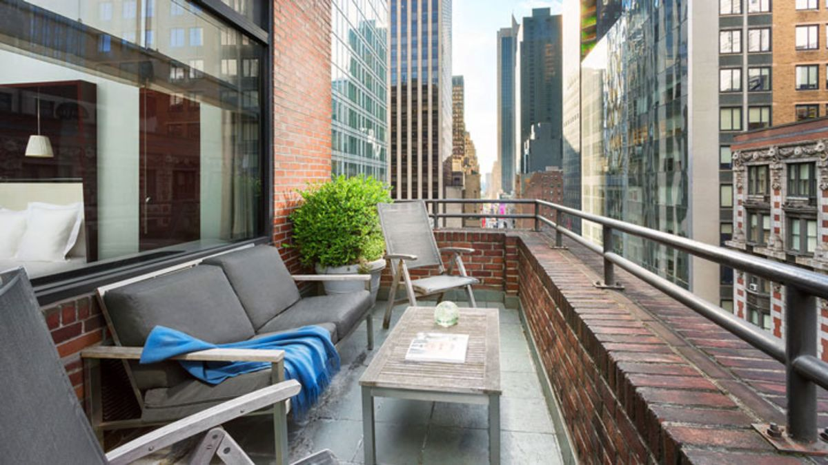 balcony-and-couches-of-royalton-new-york-penthouse