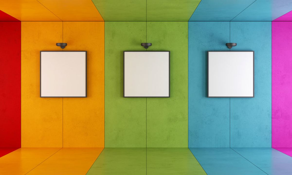colorful-wall-with-three-blank-canvases