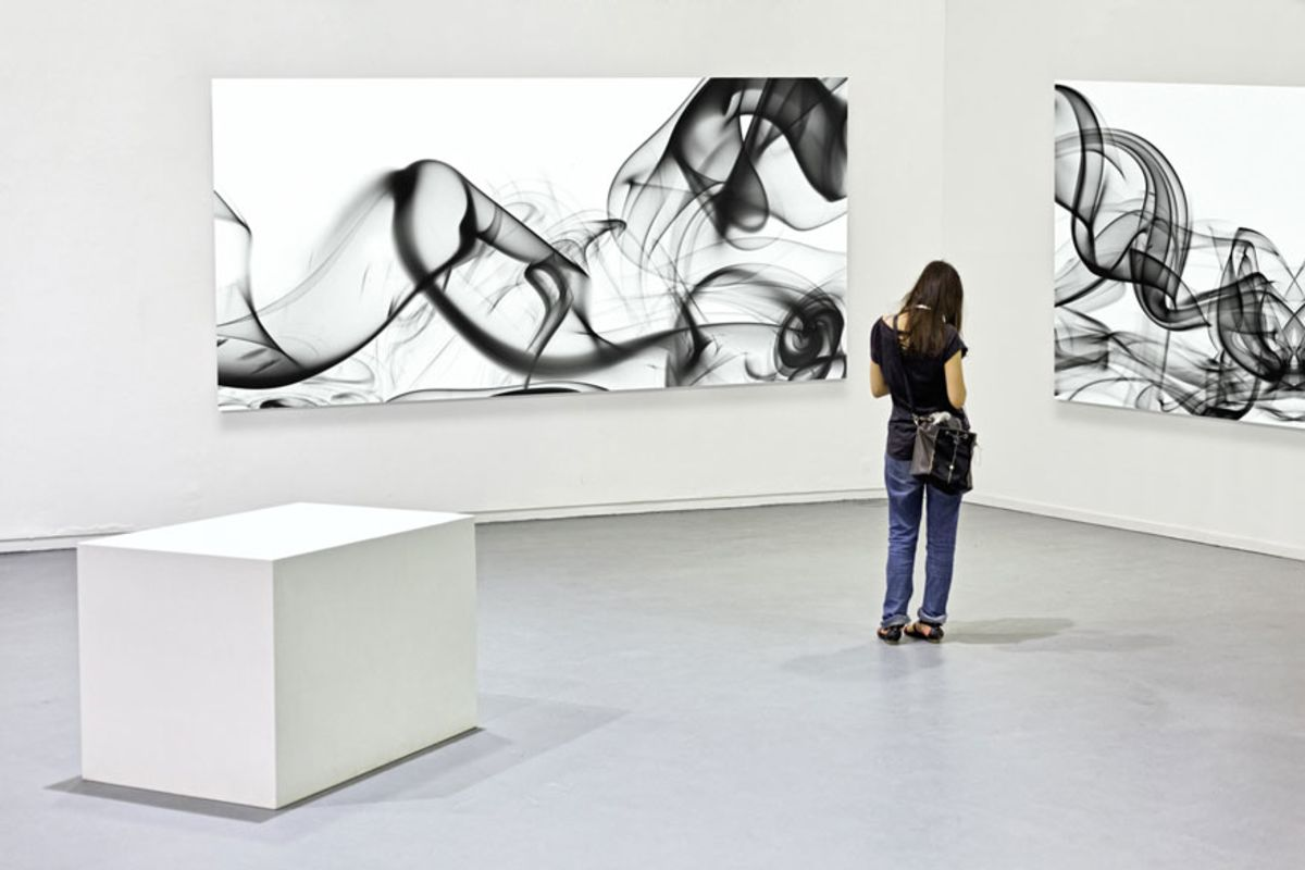 young-woman-in-contemporary-at-gallery-with-black-and-white-paintings