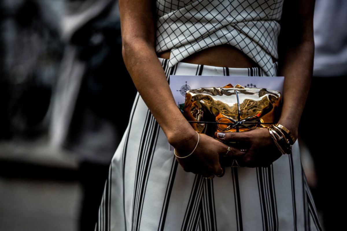 torso-of-stylish-black-woman-holding-a-clutch