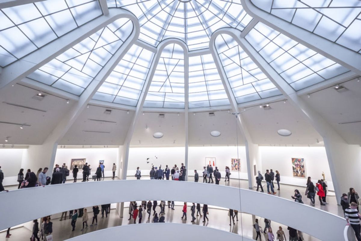 people-looking-at-art-exhibits-in-top-floors-of-guggenheim-museum-new-york