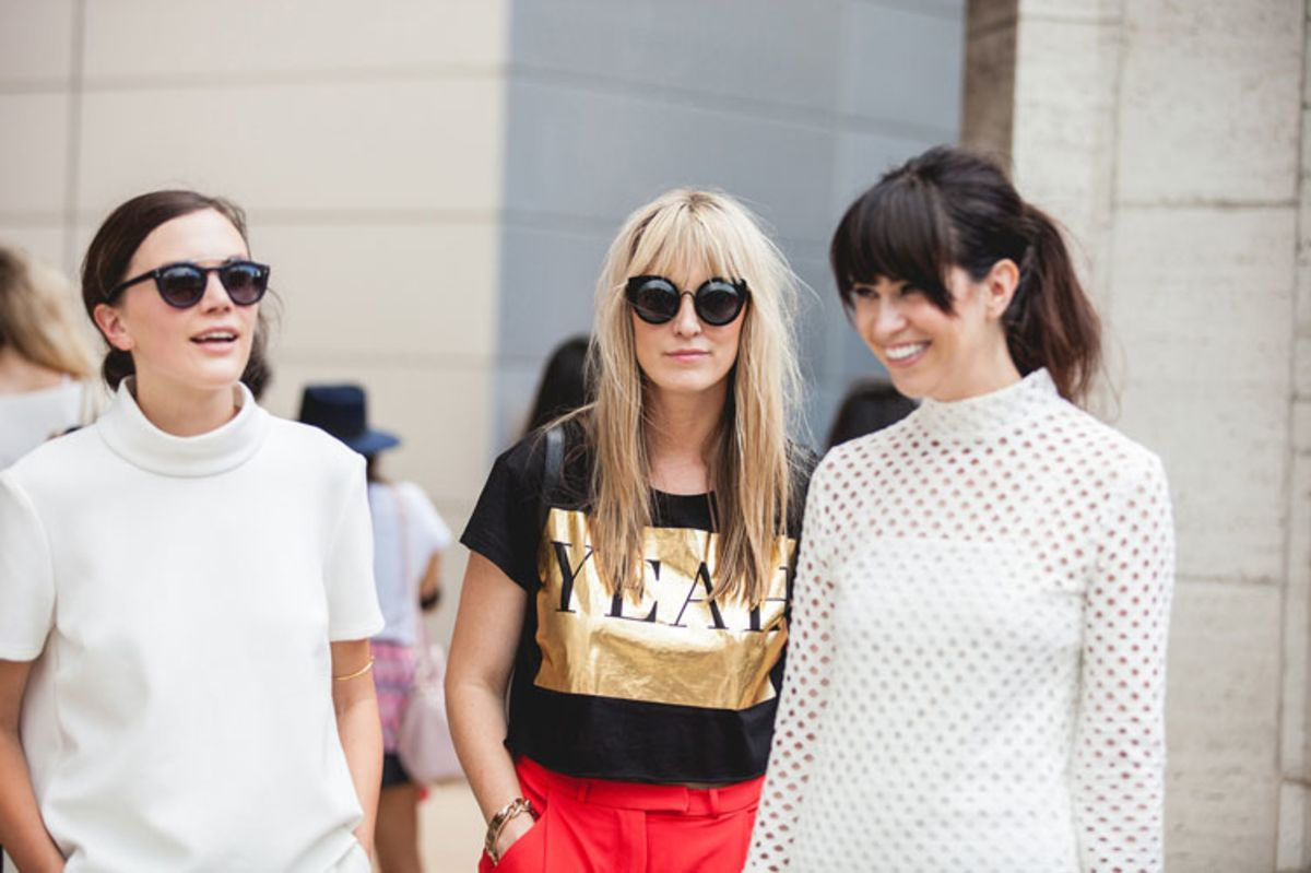 three-young-women-standing-wearing-trendy-casual-outfits