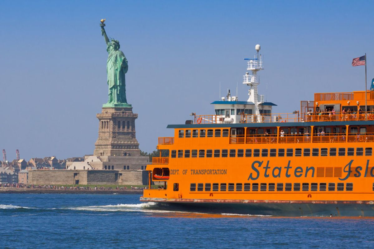 yellow-staten-island-ferry-cruising-past-statue-of-liberty