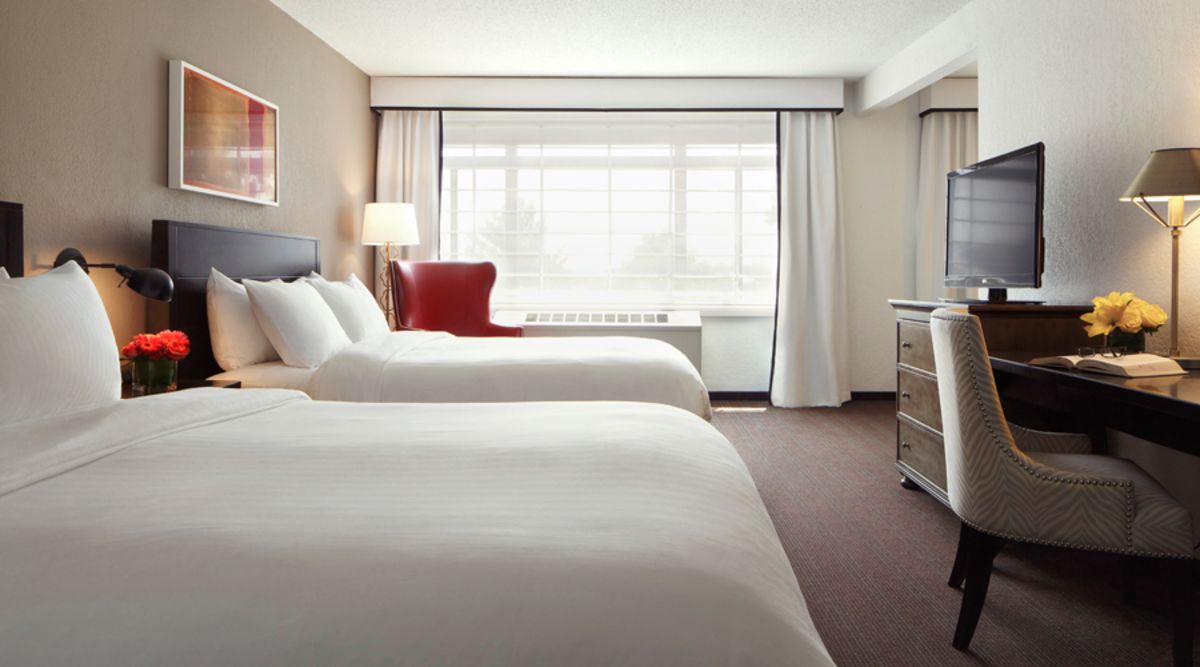 Superior Suite with two queen beds, TV, desk and chair