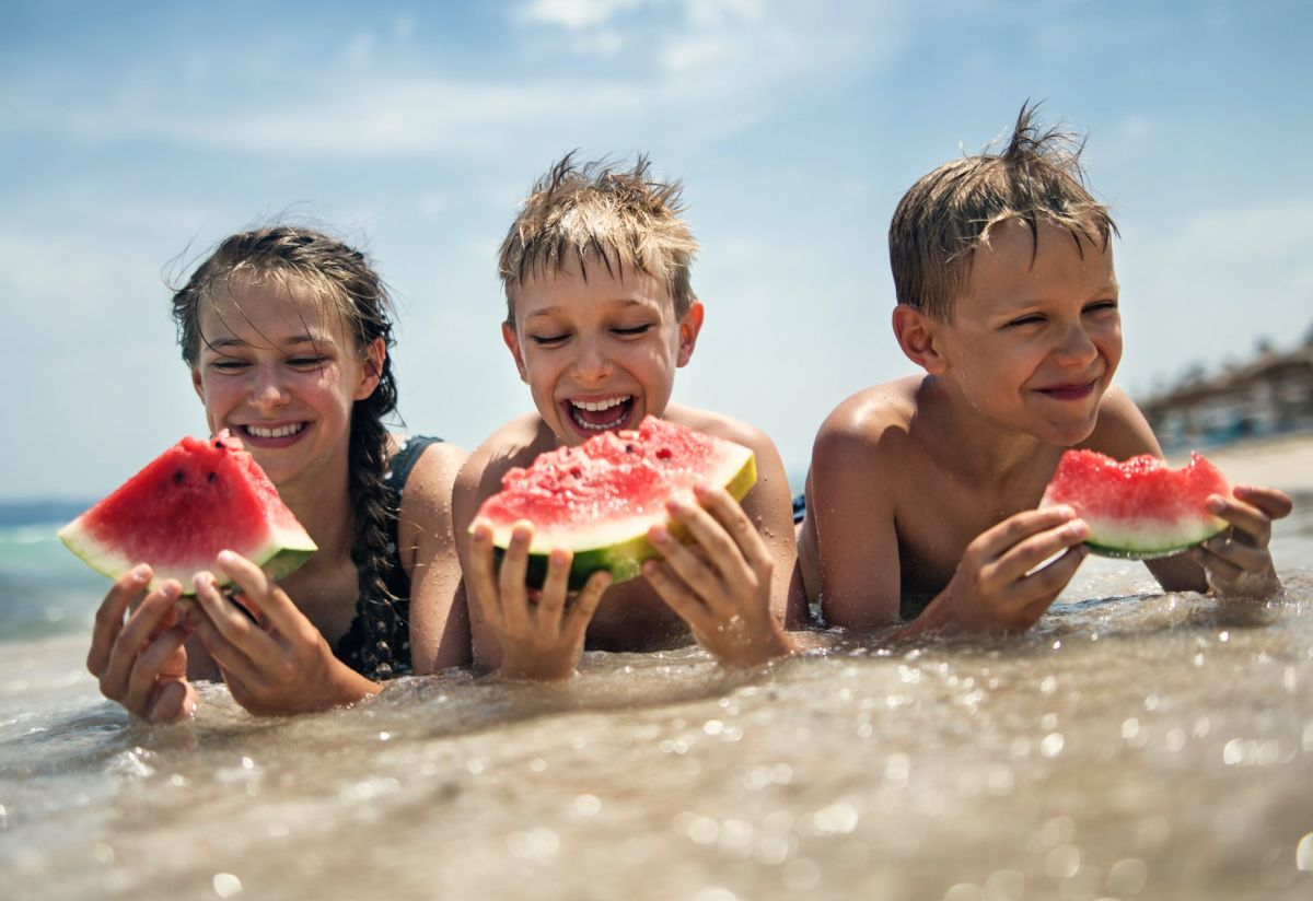 kids-eating-watermelon-on-beach