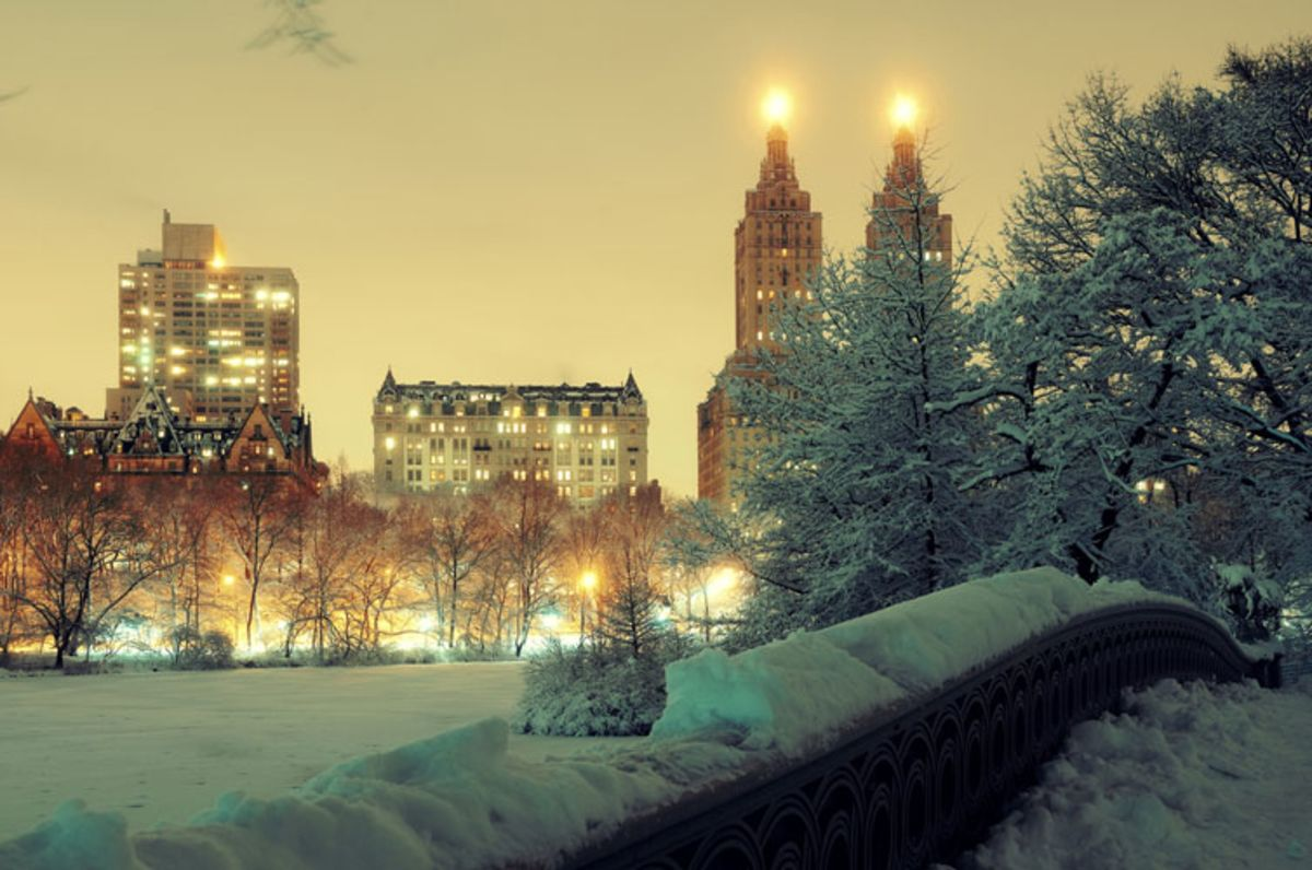 Snowy bridge in Central Park at twilight.