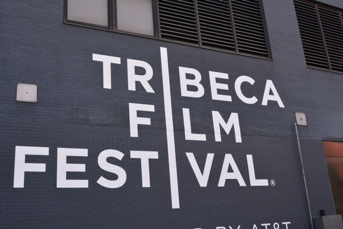 Black building with white letters advertising Tribeca Film Festival.