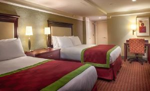 This non-smoking room features two Queen beds and a bathroom stocked with amenities.