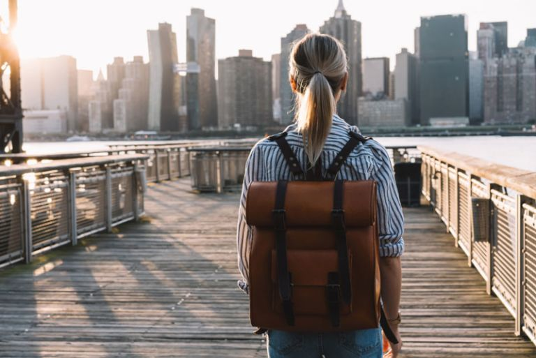 trendy-young-woman-with-backpack-walking-in-new-york