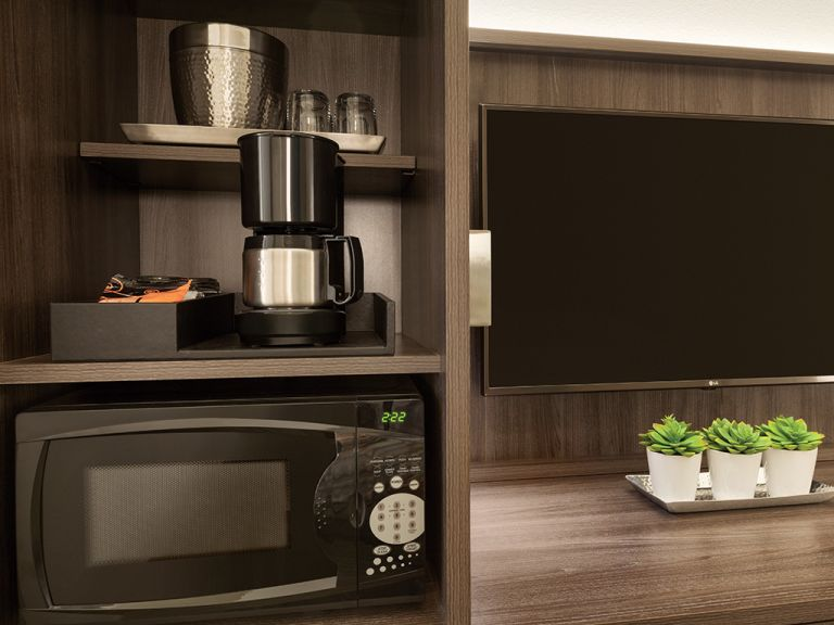 Microwave, coffee maker and entertainment area.