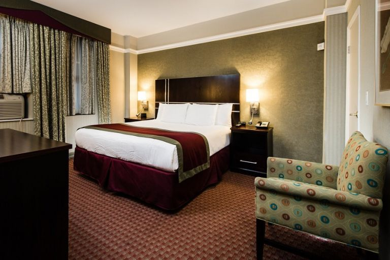 Deluxe non-smoking King room features a King bed with a microwave and mini-refrigerator.