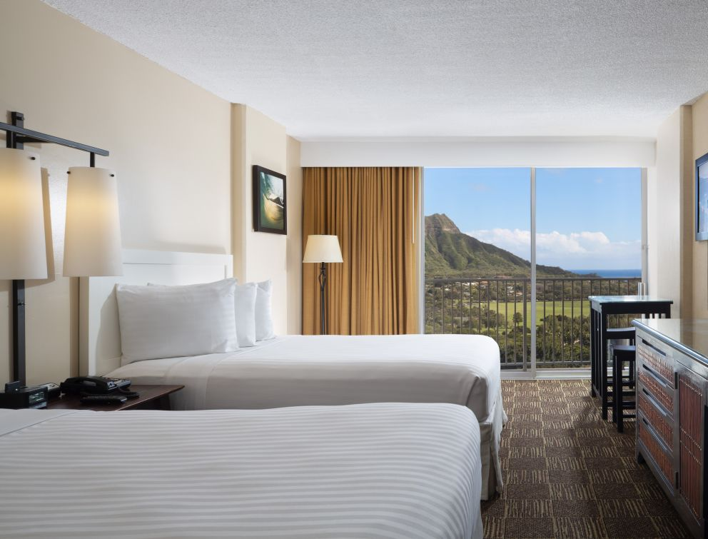 Ocean view room with 2 beds, high-top table for two, view of diamond head from balcony