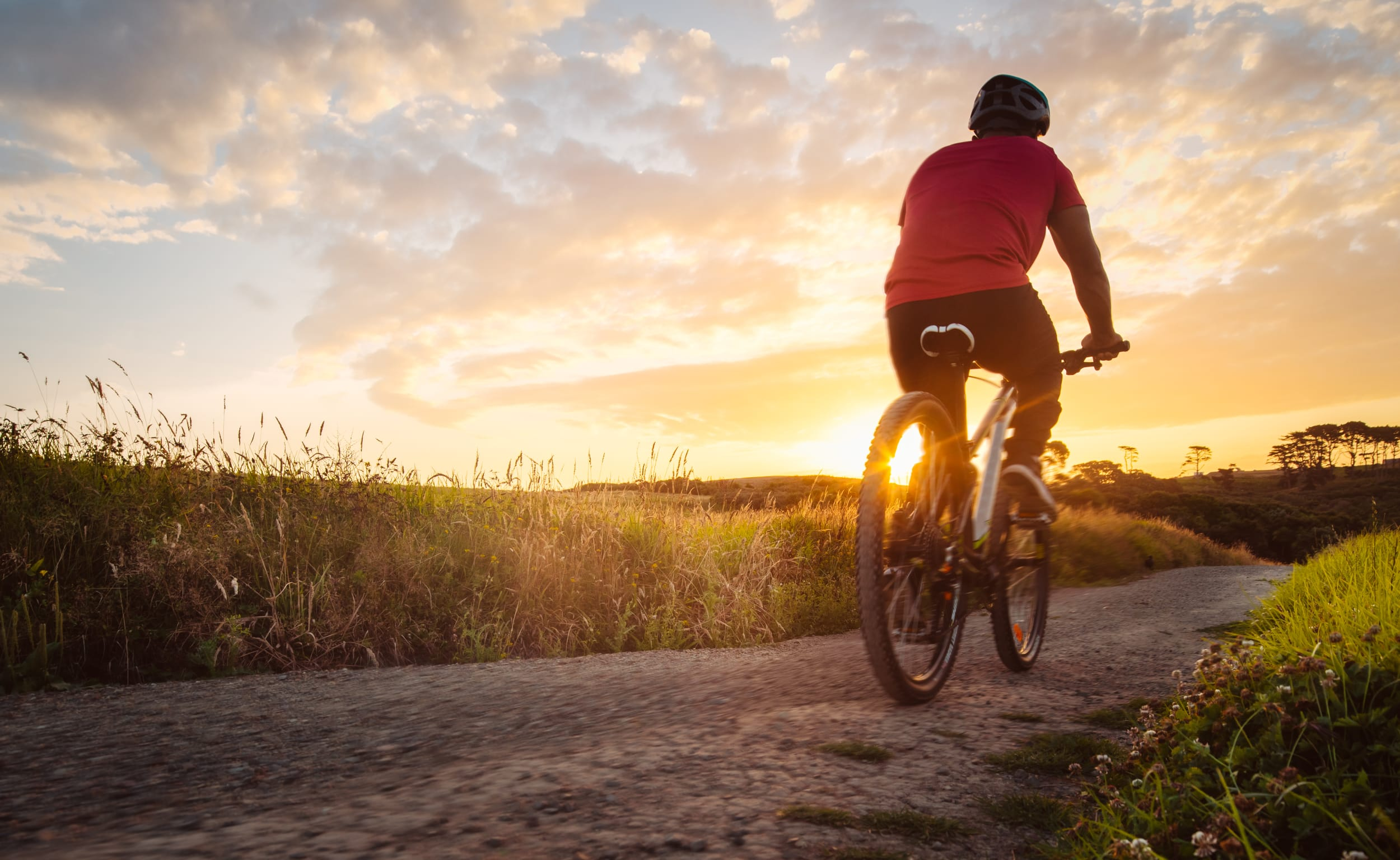 person-biking-into-the-sunset