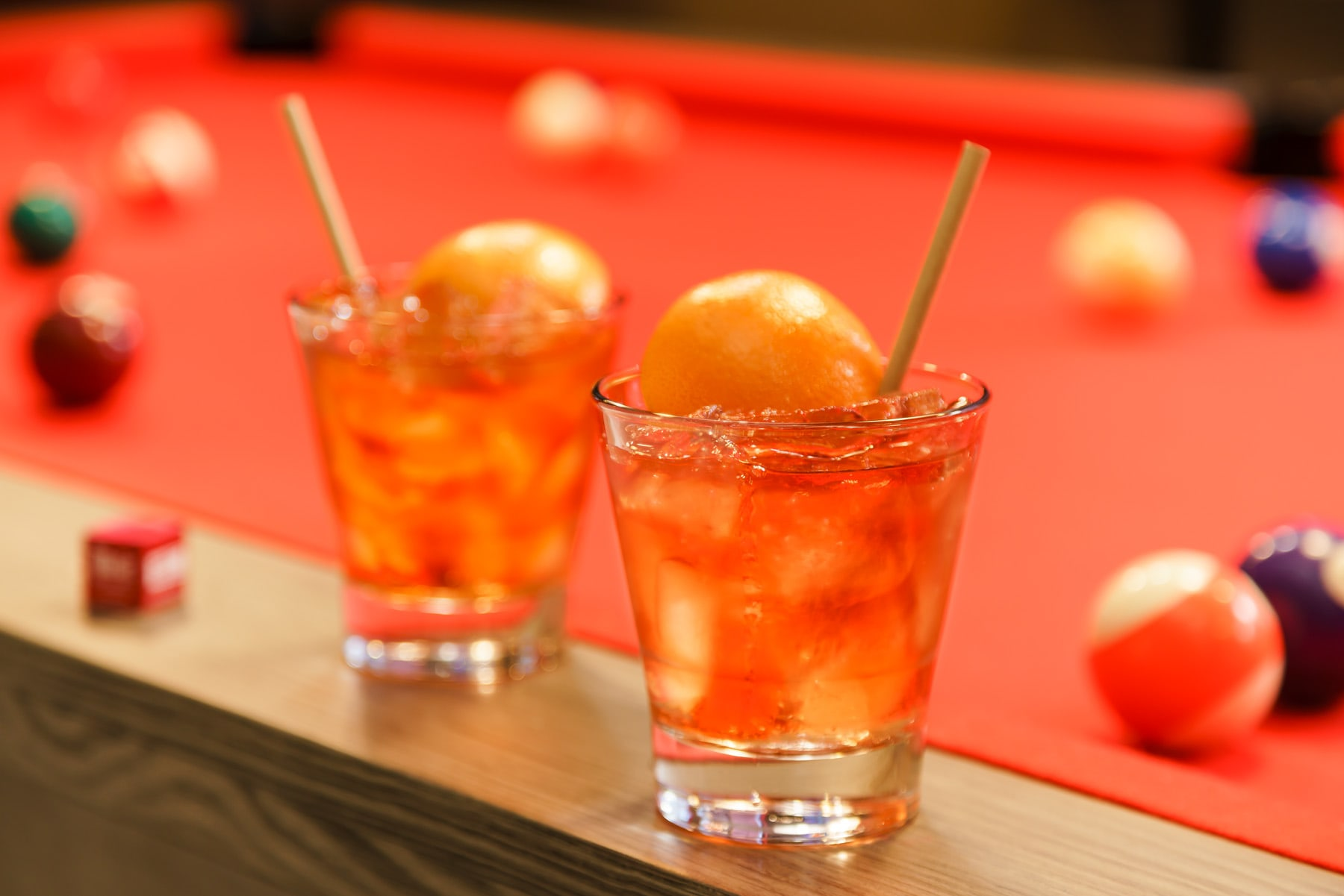 CAZBAR orange drinks placed on snooker table