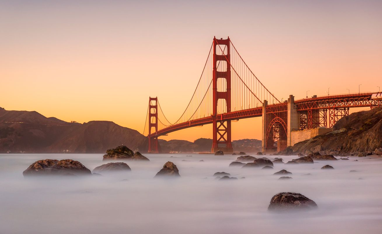 long-exposure-Marshall's-Beach-and-Golden-Gate-Bridge-in-San-Francisco-California-at-sunset-1067485378_1313x803