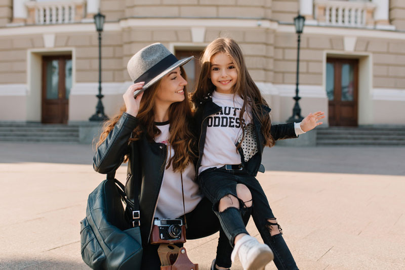 fashionable-young-mother-and-daughter-in-city