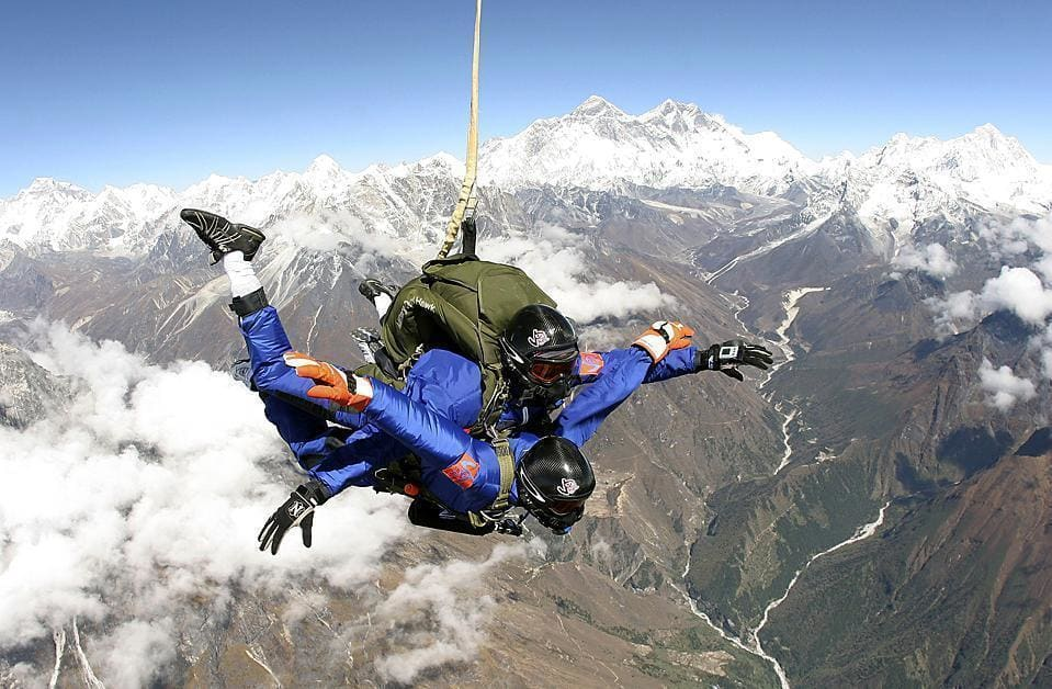 Tom Noonan of the US and Ganesh Pandey of Nepal perform a tandem skydive at an area near the world's highest peak, Mount Everest, in Nepal