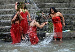 Women bathing in river during Teej festival in Nepal.