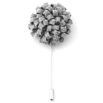 Luova harmaa kukkarintaneula