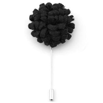 Luova musta kukkarintaneula