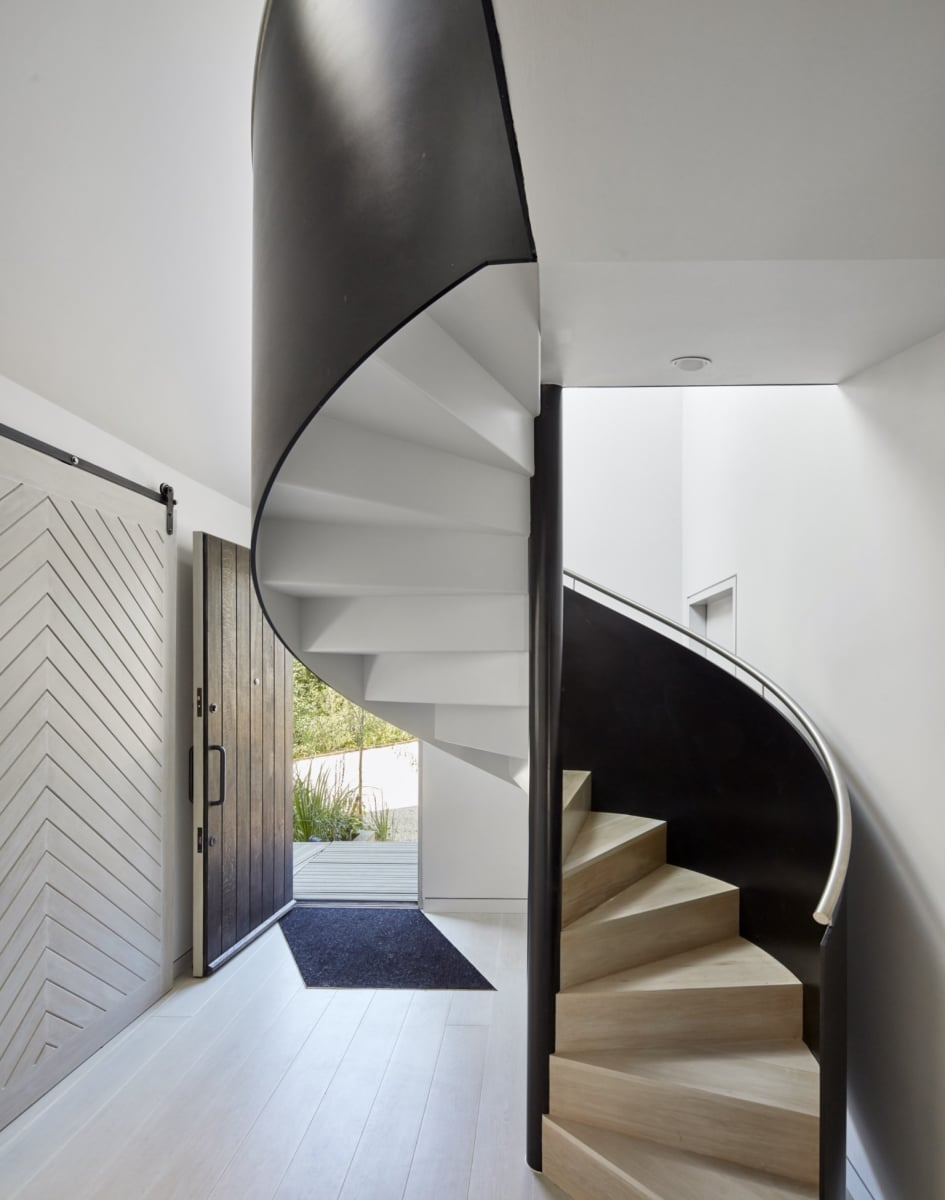 Spiral staircase in lagoonside home by Platform 5 Architects