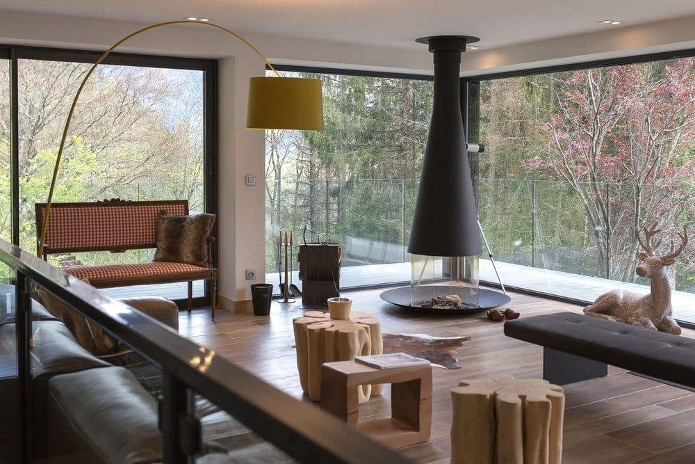 Open-plan living area in the addition to a mountain home by  Chevallier Architectes