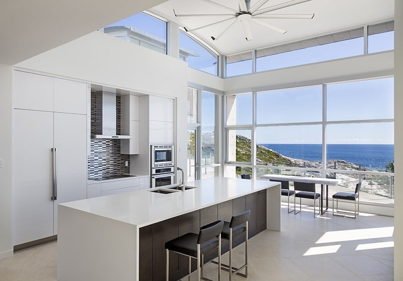 All white kitchen with views in coastal home by Alexander Gorlin Architects