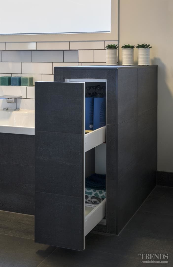 Off-set white subway tiles are a feature of this bathroom renovation