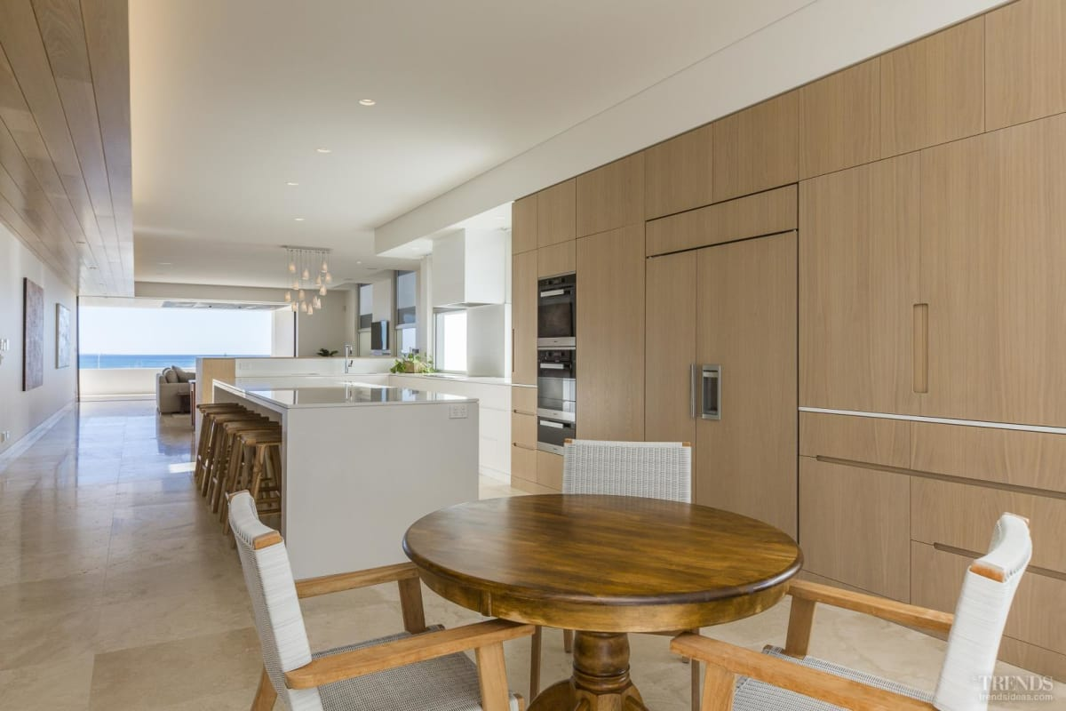 Beach tones and an integrated design are features of this family kitchen