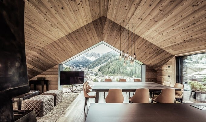 The main living area of the house is the attic with floor-to-ceiling windows providing a striking view of the landscape
