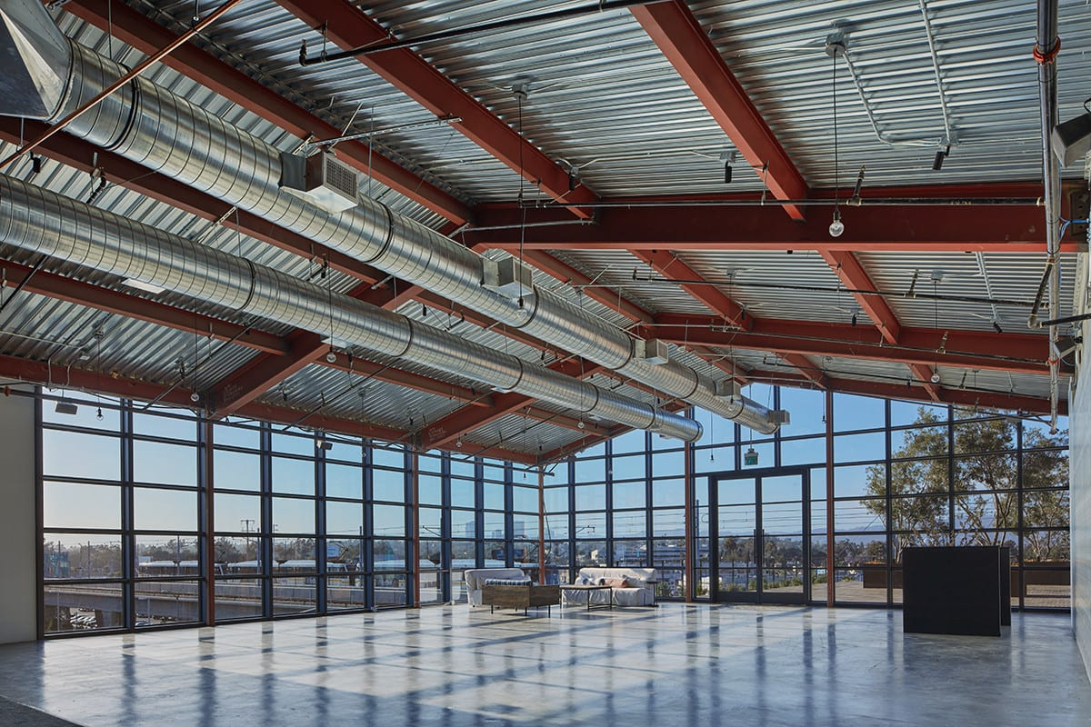 Mixed-use office, retail and hospitality hub takes design cues from railyard previously on site