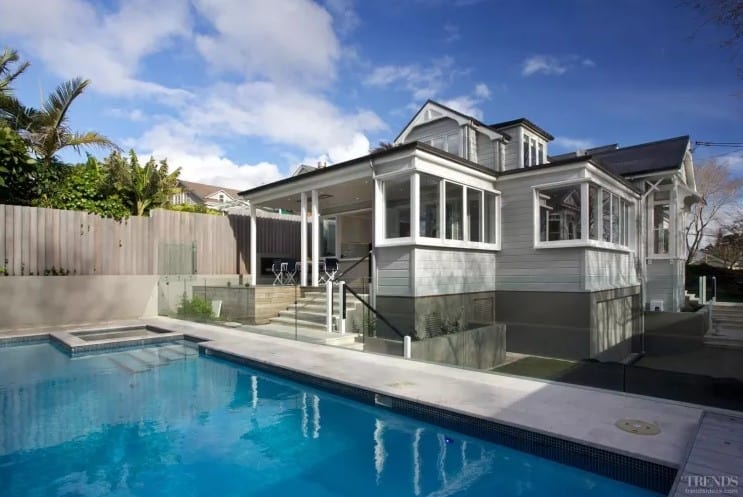 A traditional home villa renovation by Scarlet Architects, featuring an open plan family living area, contemporary kitchen, new pool and bay window