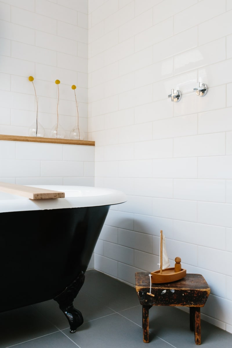 A black claw foot tub draws the eye in this bathroom