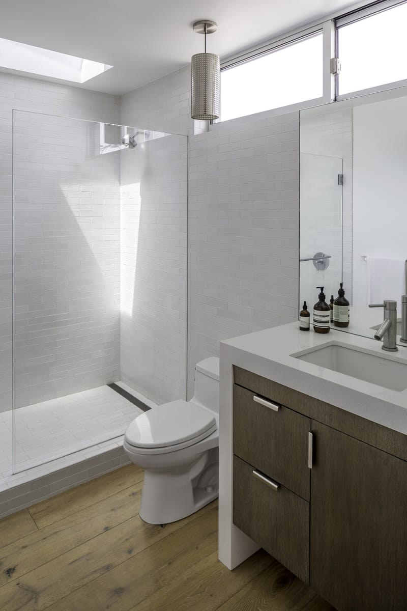 Another bathroom, this one featuring soft whites and wood tones