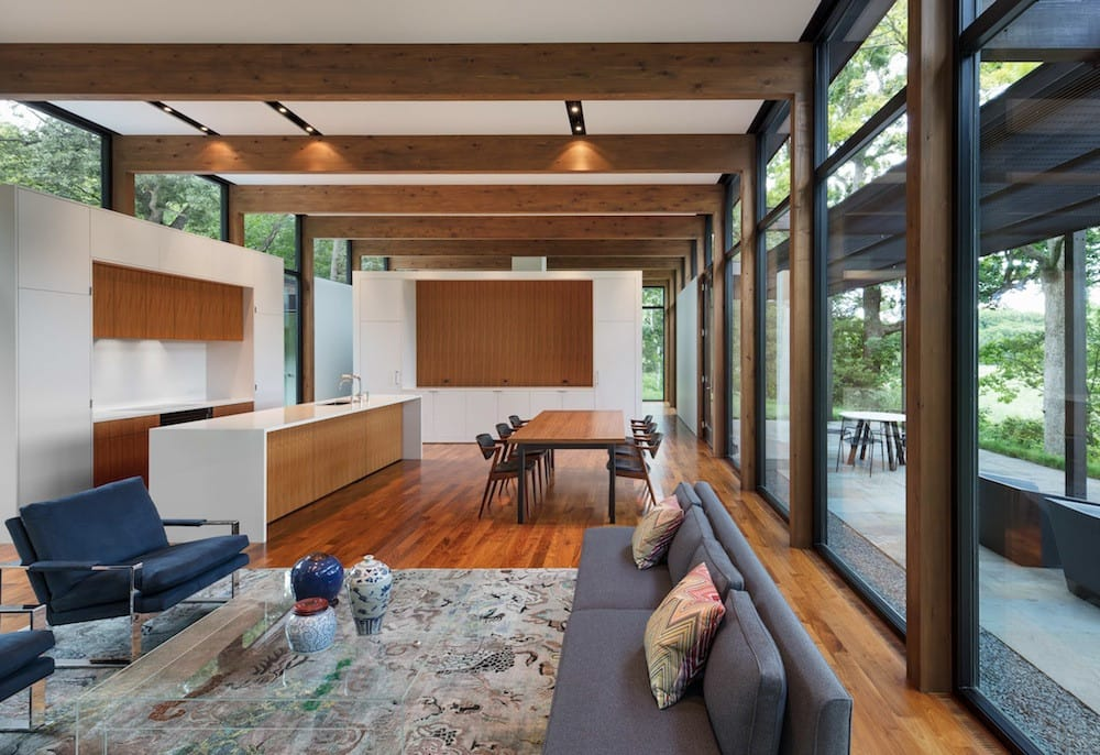 The dining, kitchen and living areas all share one large volume
